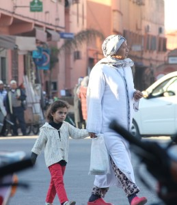 women walking the streets of morocco with kid and shopping