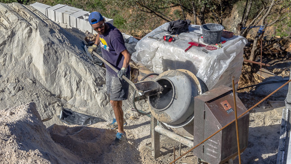 liam mixing cement at a workaway in southern spain