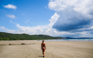 Mariana watching the clouds role in at a beach in Nicaragua