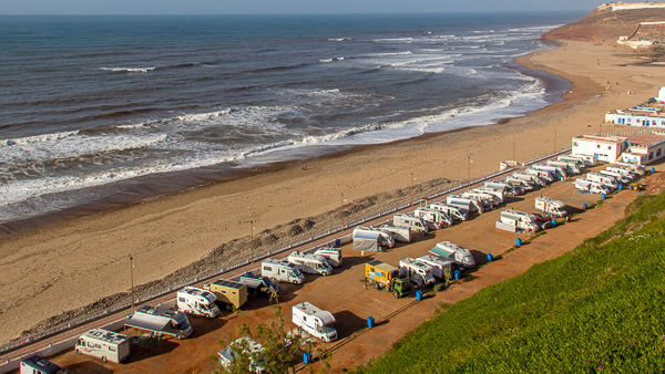 Lots of campervans parked next to the beach in Sidi Ifni, Morocco