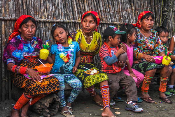 Local Guna women dressed in beads and traditional dress