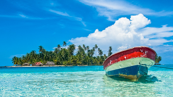 Beautiful san blas islands with a boat in the front