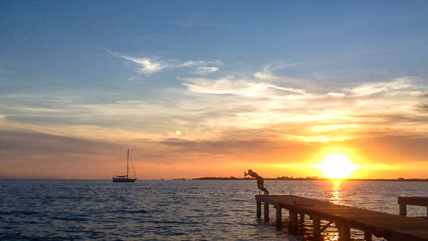 Jetty jumping at sunset on Utila