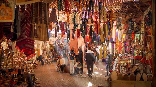 a shaded souk alleyway in Marrakesh morocco