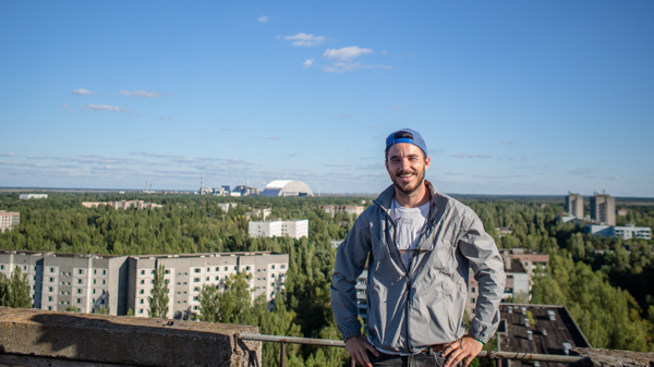 Chernobyl reactor 4 and the forrest taking over Pripyat in the background.