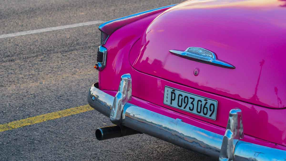 Lovely old pink car on the streets of Cuba