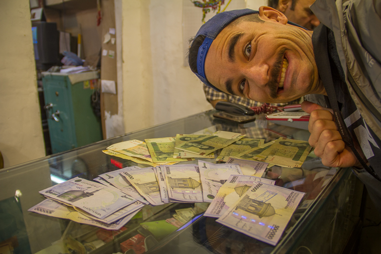 Liam with our millions of rial while backpacking iran