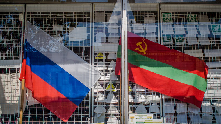 Russian and Transnistrian flag in a window