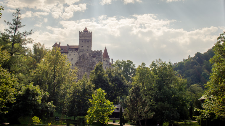 Draculas castle or bran castle hidden between the trees