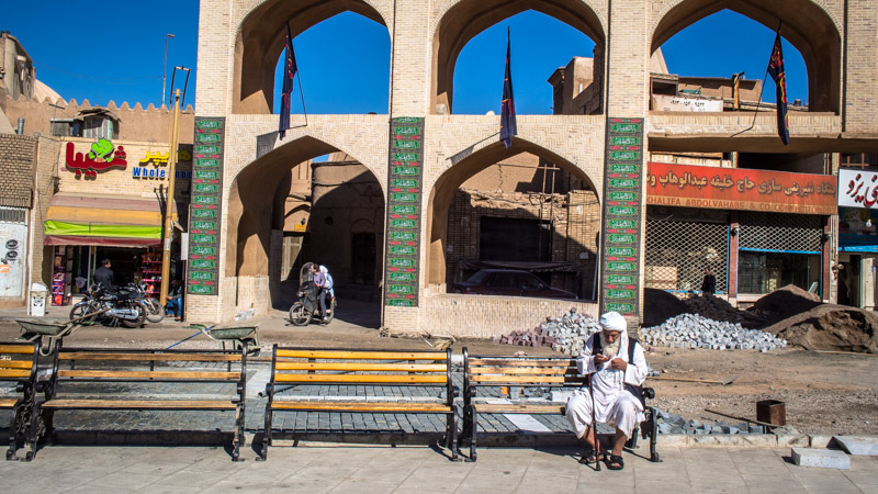 Old man on a bench in Iran