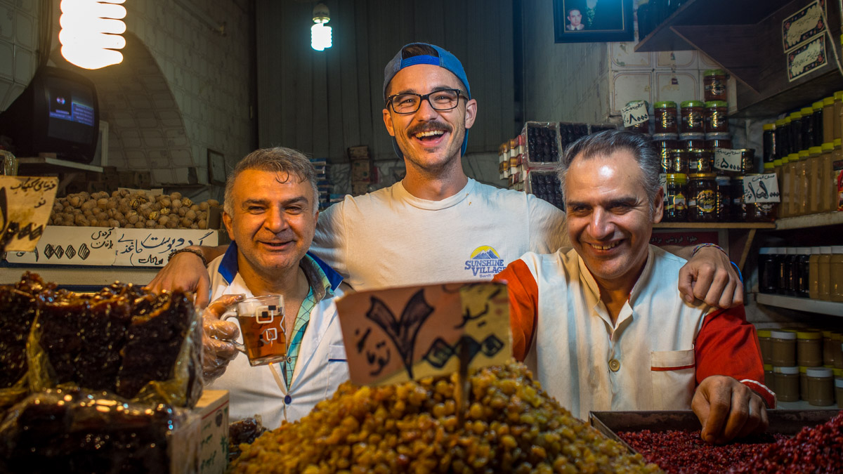 Liam Smiling behind the counter of a nut shop in the bazaar of Shiraz