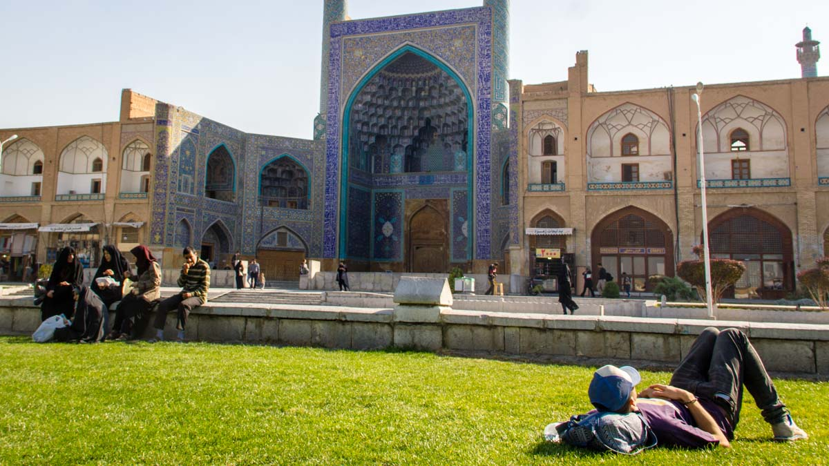 Liam sleeping on the lawn couchsurfing in Esfahan